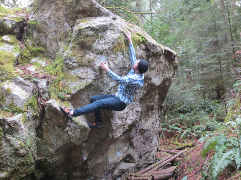 Rock Climbing Photo: Mikhail Y. hits moves from the good left arete and...