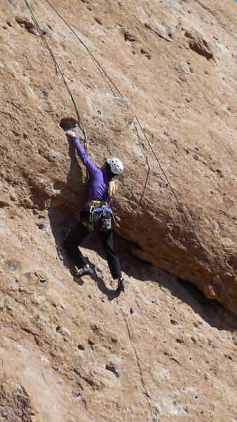 "Reaching the hole on ""Endymion."" For those of short stature this may be the routes crux."
