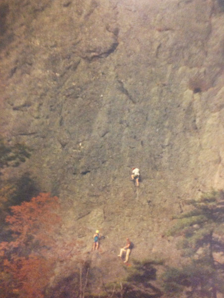 Old photo of climbers on Green Grizzly face, taken from across Rte 41, at the outlet to Fisher's Pond