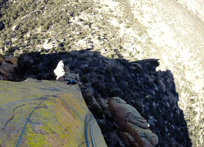 Top down view of Alan North finishing up on the beautiful arete of Stiletto