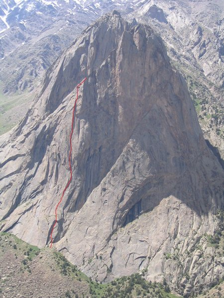 The red line indicates route, and bolted rap route. In the photo, it appears to stop short of the summit. However, this is the summit ridge, and easy scrambling right and to the summit. The rock in the background is actually a completely separate mountain.