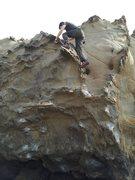 Rock Climbing Photo: Friend-o topping out Tin Man.