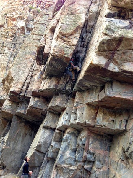 Matt T. catching the no hands rest in the chimney on The Balvenie a 5.11 at The Single Malt Wall.