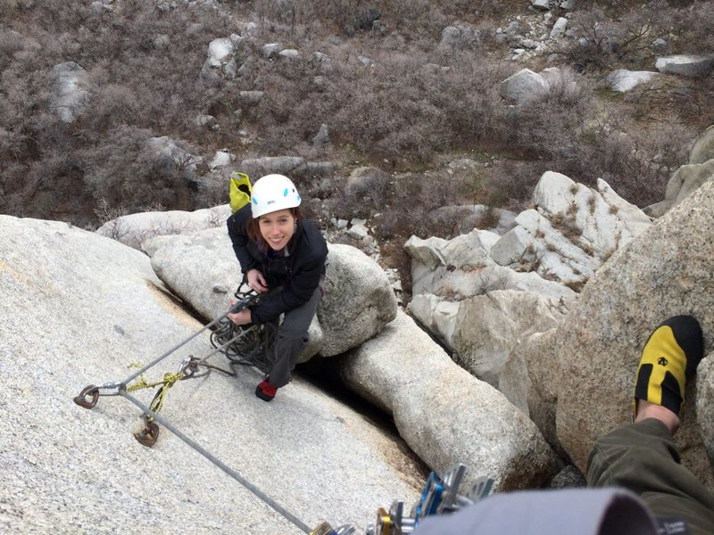 Taking a break in the offwidth to get a photo of Anna at the belay