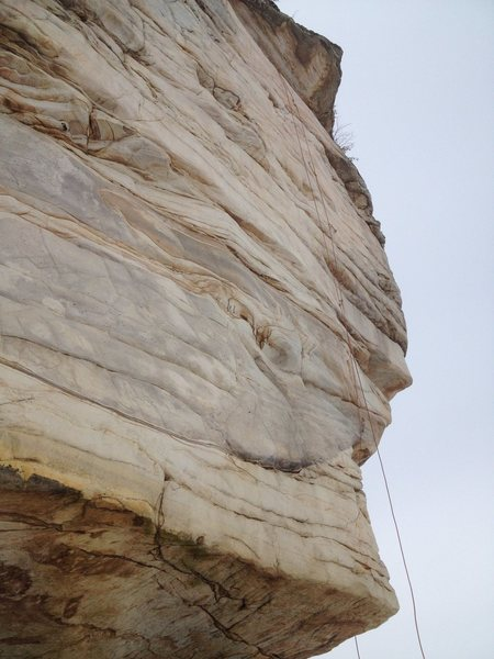 You can see the route by the path of the rope. Note, you start on the right side of the arete and step around.