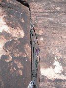 Rock Climbing Photo: Thin gear anchor on pitch 2