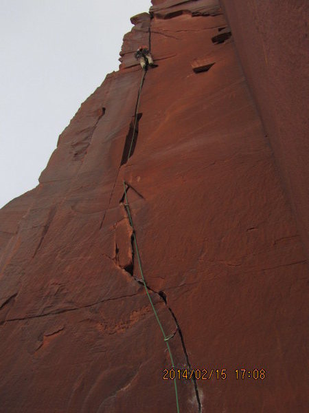 """almost to the top... who ever went to the right off the ledge has no clue how to find a route? but has plenty of time to  scratch in """"no anchors"""" on more then one rock on top of pitch one"""