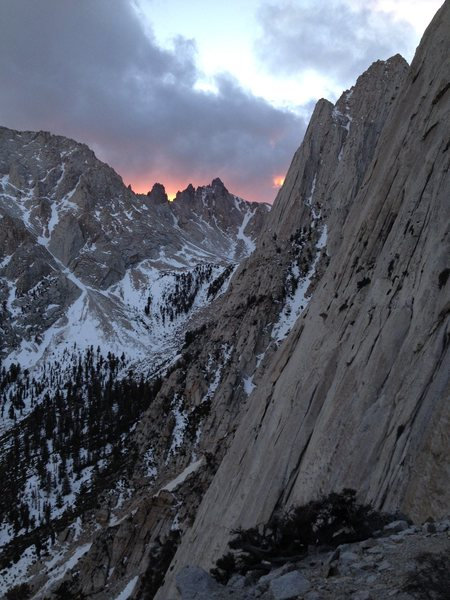 A spectacular winter sunset over the Corcoran Pinnacles as seen from the bivy ledge atop P5 on the Direct South Face