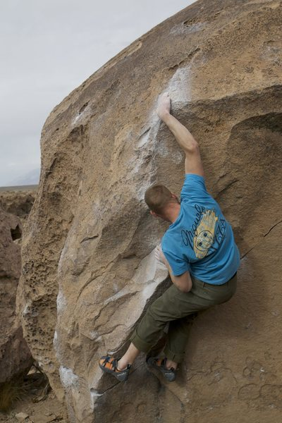 Luke Lydiard sticking the slap on The Clapper, Happy Boulders, Bishop, CA.