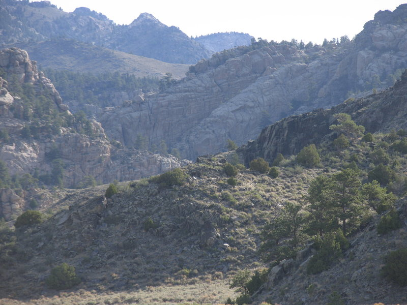 The top of the South facing wall of Gneiss Canyon is the big brown-yellow wall right of the Laramie River Canyon.