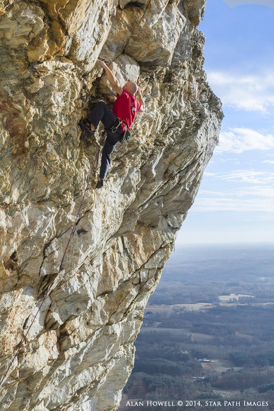 Stunning exposure and great climbing. Seth Tart on Jesus Christ Superstar. One of the most scenically photogenic routes in the state.