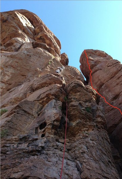 Red line marks upper part of the route. DAS eyeing the lower crux of Raptor's Roof.