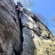 Approaching the anchors on Eclipse (5.6) at Breakneck Rocks in Connellsville, PA.
