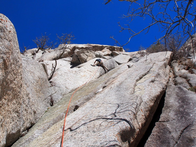 After the pin, climb to the really good undercling/pod, look up for the bolt and the jug to it's left and pull up.