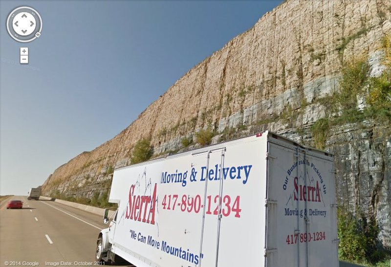 Google streetview showing the road cut during the warm season. Also in the picture is a freight company truck delivering mountains to Wisconsin.