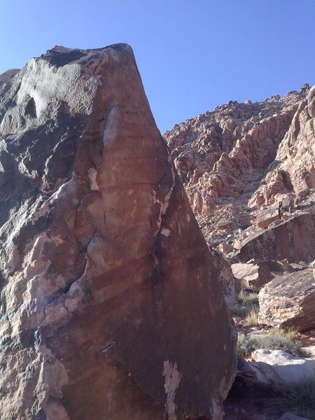 Climb up the big holds to a crux near the top
