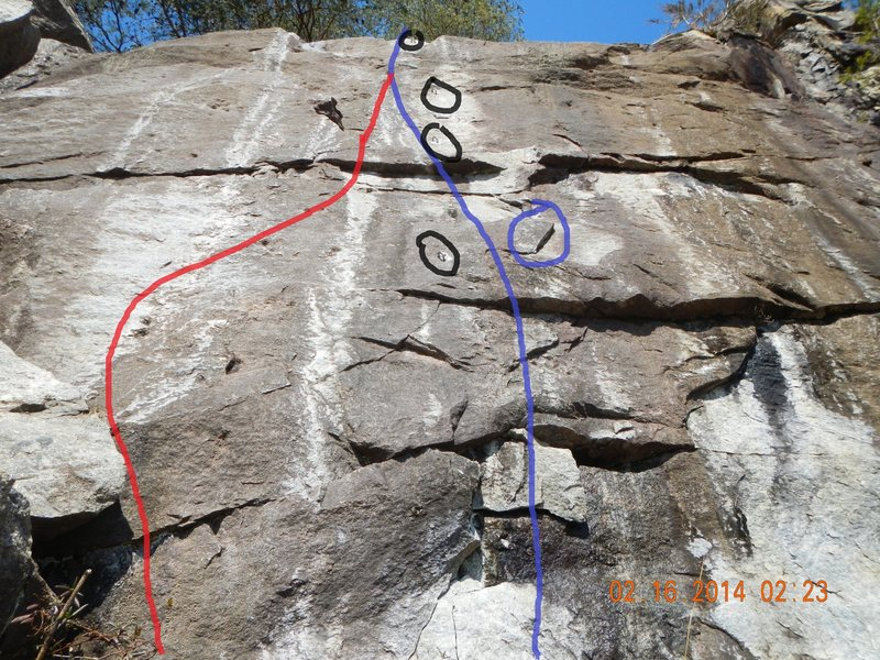 The intended start is shown in blue and the easier start is shown in red (more or less). Shorter climbers will find it difficult to start under the bolt as a critical hold is a little reachy (circled in blue).