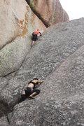 Rock Climbing Photo: The woman wearing black is climbing Cornelius.