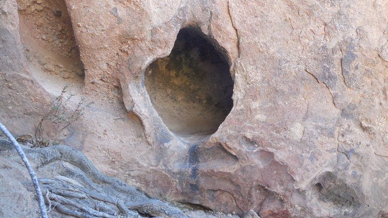 A unique hueco or solution pocket at the base of the west face of the Tower of Babel (aka the Ten Gallon Hat).