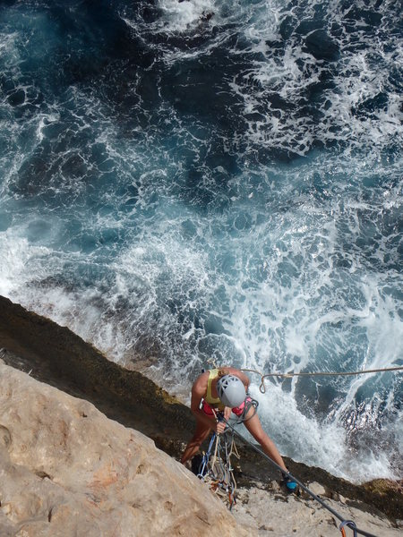 Hilary at the belay on Spiral Staircase. If surf is high, you get soaked!