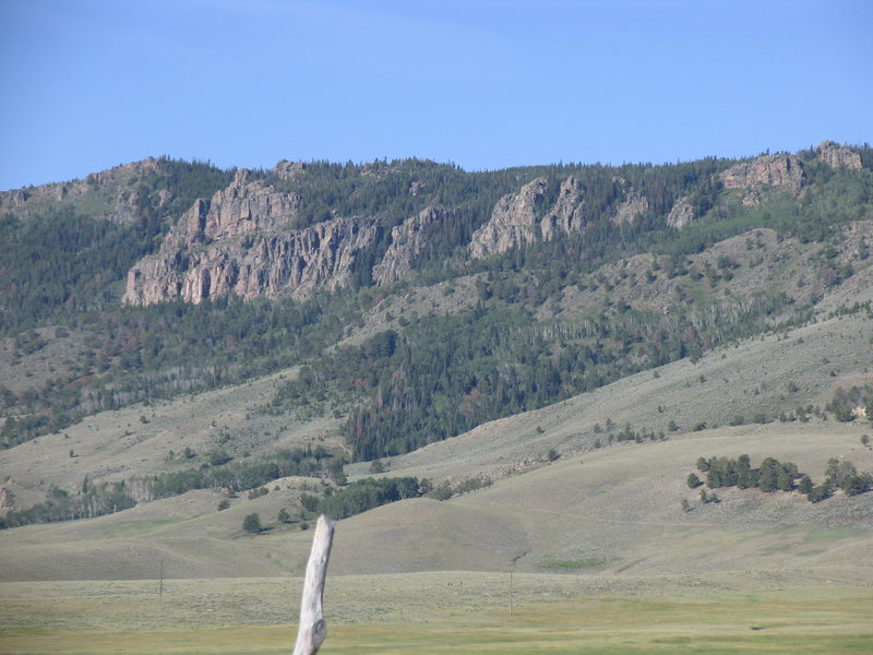 The east facing granite escarpment of the Shirley Mountains.  The grassy lowland is mostly private.