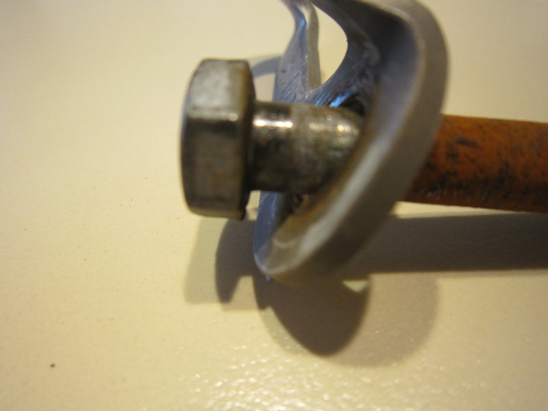 This shows the impact area of the hanger on the bolt.  Again it is shiny from unscrewing it with weight on it.