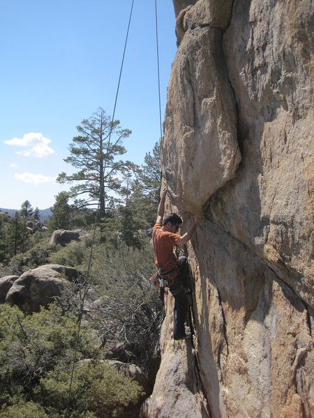 Scott Nomi on top rope, approaching the first overhang.