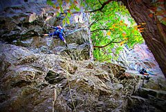Rock Climbing Photo: Suzy Williams on lead  Beautiful view of Lake Geor...