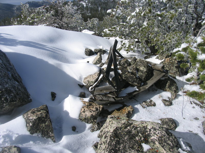 Dilapidated surveying framework circa 1948 [for holding perhaps antennae or mirrors] on east summit of Squaw Mountain.