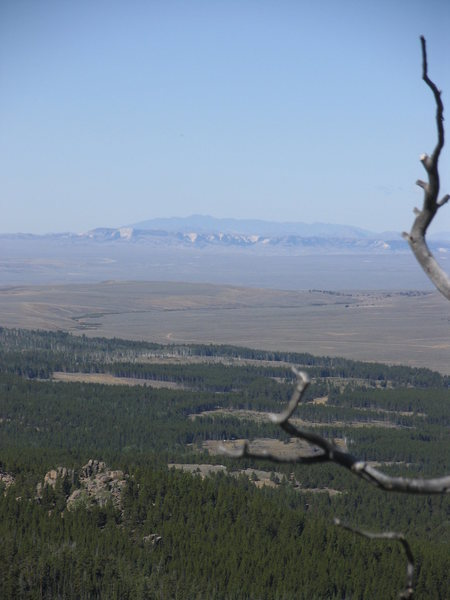 Looking west across Shirley Basin from Warbonnet summit to the Ferris Mountains with the whites of the Chalk Mountains appearing below them.