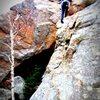 Ben Michaels starting the boulder-y crux.