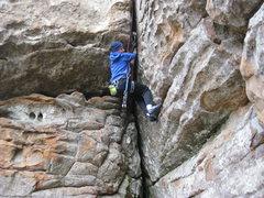 Rock Climbing Photo: Fist jamming through the crux