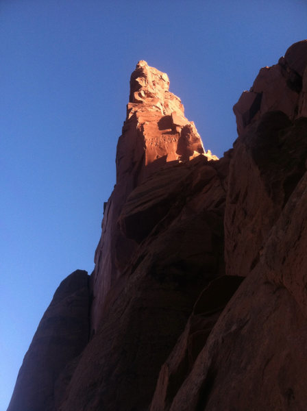 Looking back up at Monster Tower as the sun's glow hits the upper reaches of the tower.