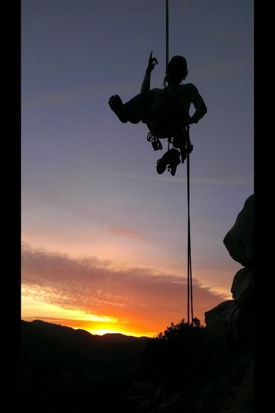 Rock Climbing Photo: Chris Norwood rappelling into the sunset!