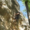 Melissa leading Monkey Boy 10c. The route overhangs.  8 feet right of Ezra's Shelf.