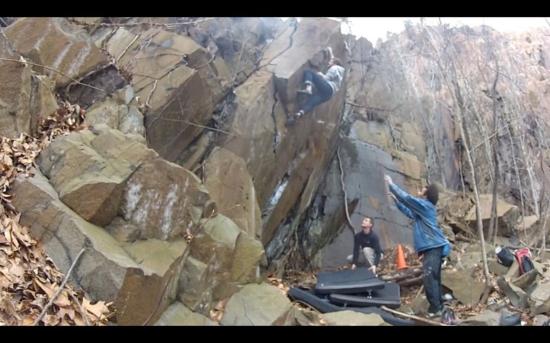 Sean about to pull around the arete and onto the slab!