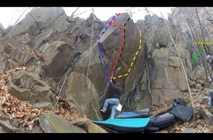 Here is a beta photo of the wall. The climber is on the start hold, for all of the lines. <br /> <br />Blue - Kyle's Crack <br />Red - Toni Harp's Resignation <br />Black - Magical Thinking <br />Yellow - Toni Harp