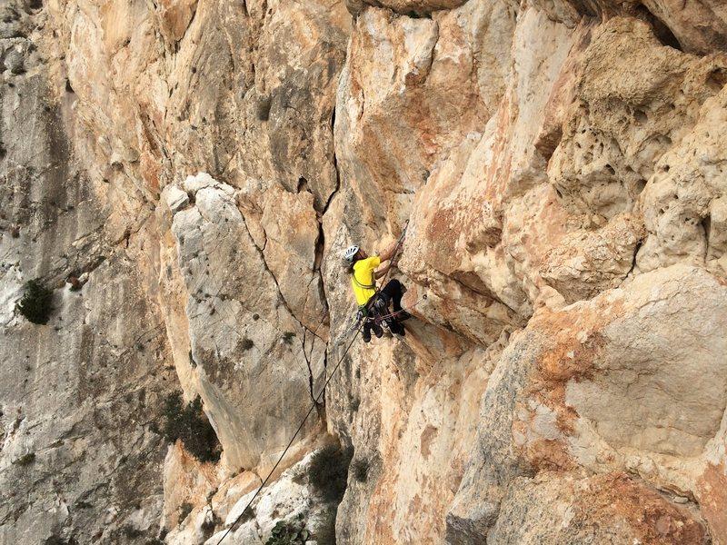 José Ortega surmounts the overhang on pitch 5 of Costa Blanca on the Peñon D'Ifach in Calpe, Spain.