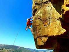 Rock Climbing Photo: John Reinig almost through the roof crack and into...
