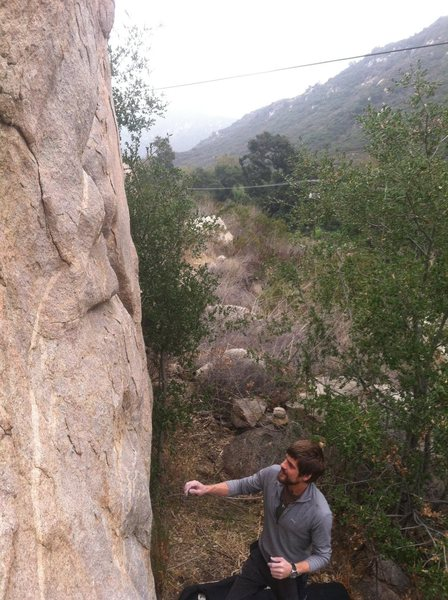 Nico checking out this nice V3 face problem on the fourth boulder up the trail.