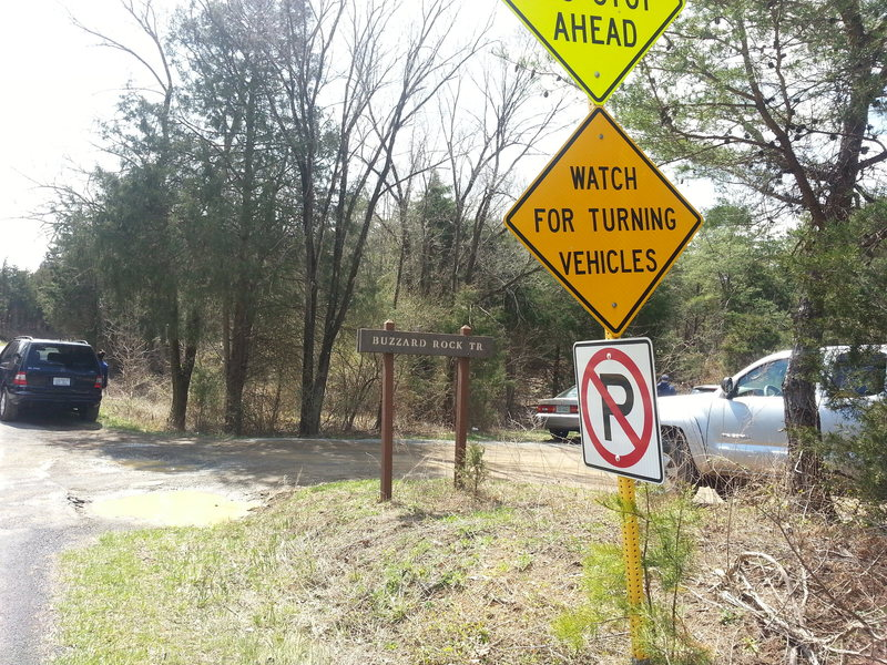 View of entrance to trailhead parking lot as you head south on Mountain Rd.
