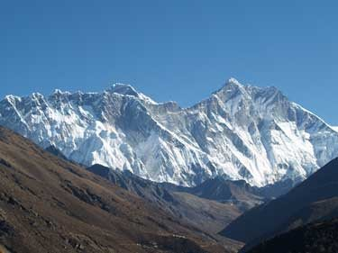 Mt. Everest's summit looms above Nuptse's long ridgeline, and Lhotse is to the right. <br> by Dougald MacDonald.<br>