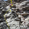 Scramble to bolt/to some fun climbing above, short, most challenging at the top