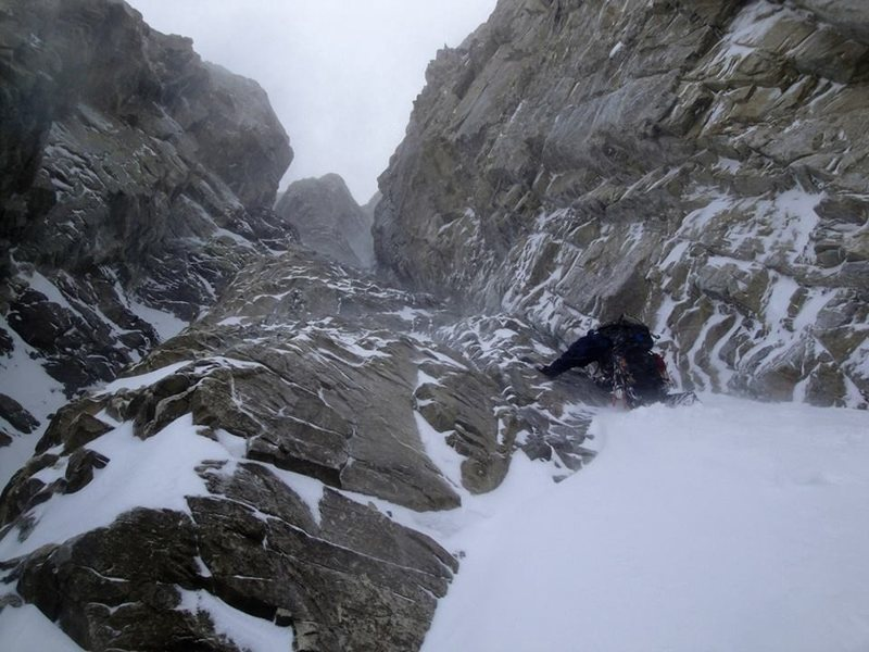 Start of pitch 4. In the picture we are descending due to massive spindrift avalanches funneling down the route.