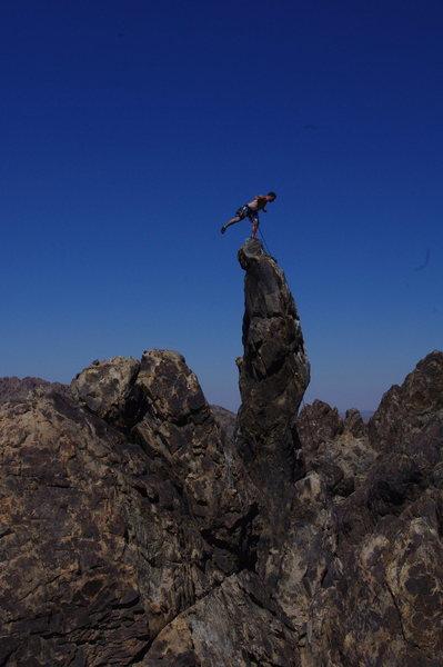 Balancing on the Crooked Dick, Sawtooth Canyon, CA.