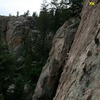 Lengthy 5.8 route underneath large overhang at top of rock. Protect first 15-20 feet with medium nuts/small cams. Great rests and views. Highest bolted climb on this wall.