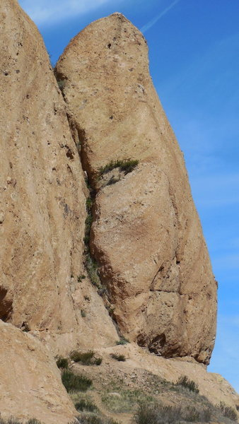 "The east face of the Ear or Shrike Temple. ""Honeybee"" climbs this narrow face/arete, past ten bolts."