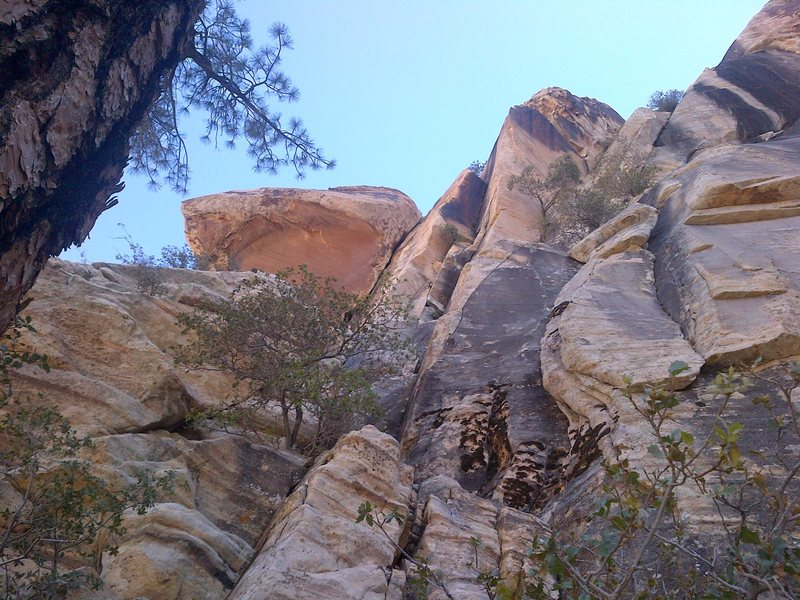 looking up at the first pitch, climbs the face and crack in the orange corner