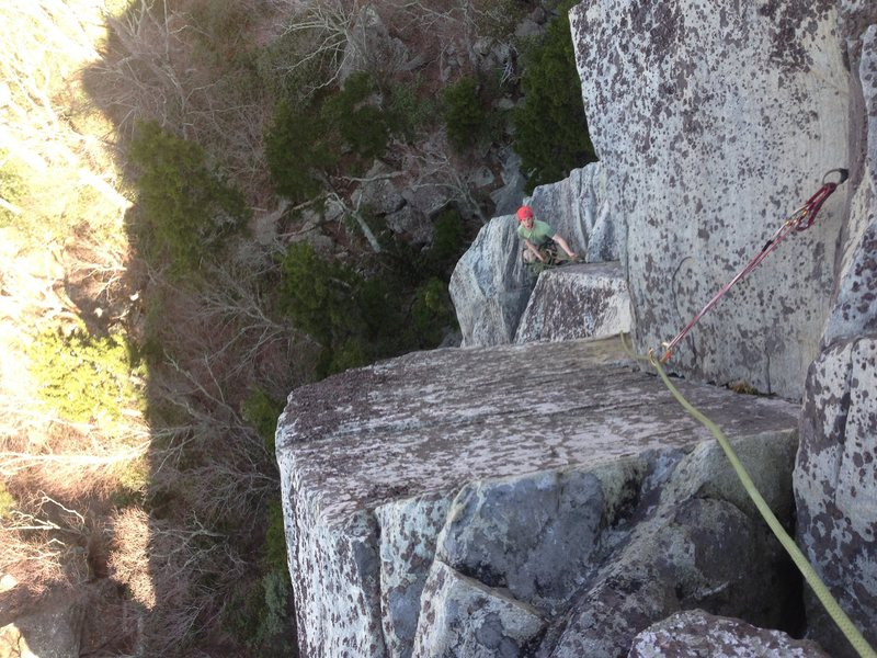Looking down after pulling the very fun crux move on P2 of KB Capers, 5.10.
