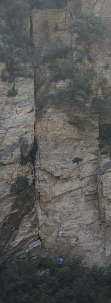 "A shot from a distance of climbers on ""The Grungy Cave."" The awkward cave crux is clearly visible at the top of the route."